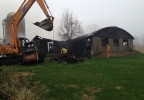 Firefighters on the scene of a barn fire in the town of Almon, Monday, May 12, 2014. (WLUK)