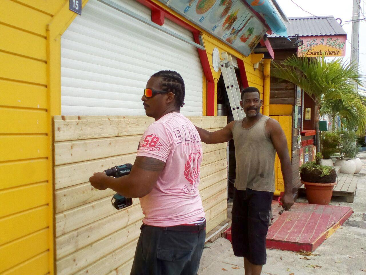 Men board up buildings ahead of Hurricane Maria in Sainte-Anne on the French Caribbean island of Guadeloupe, Monday, Sept. 18, 2017. Hurricane Maria grew into a Category 3 storm on Monday as it barreled toward a potentially devastating collision with islands in the eastern Caribbean. (AP Photo/Dominique Chomereau-Lamotte)