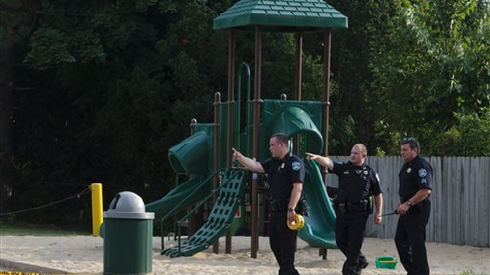 Kentwood police investigate a stabbing that occurred in a playground in Pinebrook Village, in Kentwood, Mich., on Aug. 4, 2014. Police say a 12-year-old boy has stabbed a 9-year-old boy at the playground in western Michigan, sending the child to a hospital. Police also didn't immediately release detail on the condition of the wounded child. The older boy was taken into custody for questioning by police. (AP Photo/The Grand Rapids Press, Joel Bissell)