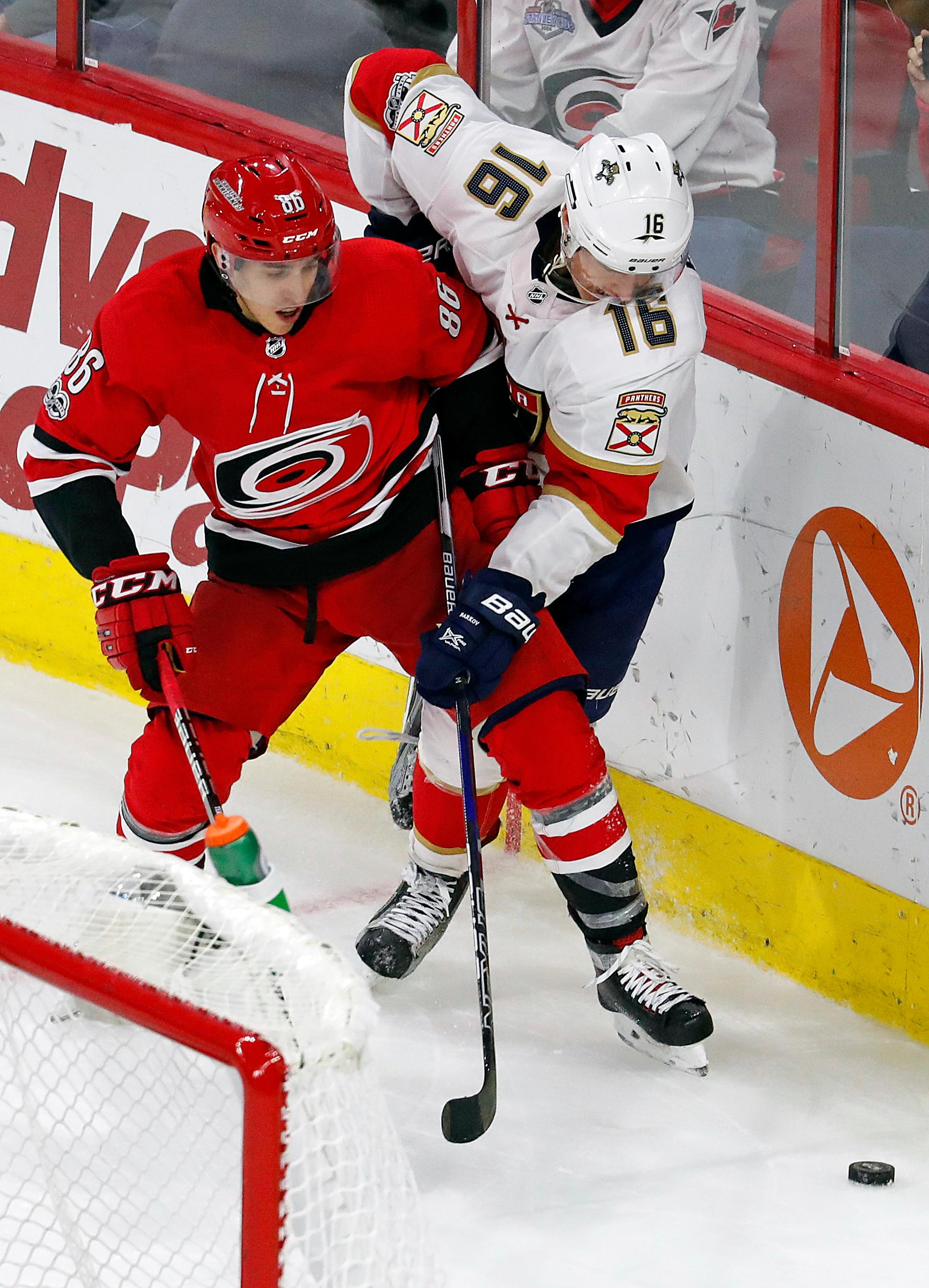 Carolina Hurricanes' Teuvo Teravainen (86) tangles with Florida Panthers' Aleksander Barkov (16) during the third period of an NHL hockey game, Tuesday, Nov. 7, 2017, in Raleigh, N.C. (AP Photo/Karl B DeBlaker)