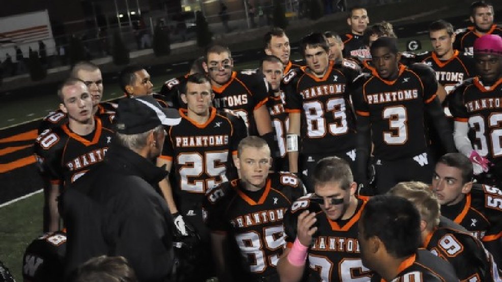 Bill Turnquist talks his team after a win over Seymour during the 2012 season. The former West De Pere coach is now assisting at Bay Port this season. (Doug Ritchay/WLUK)