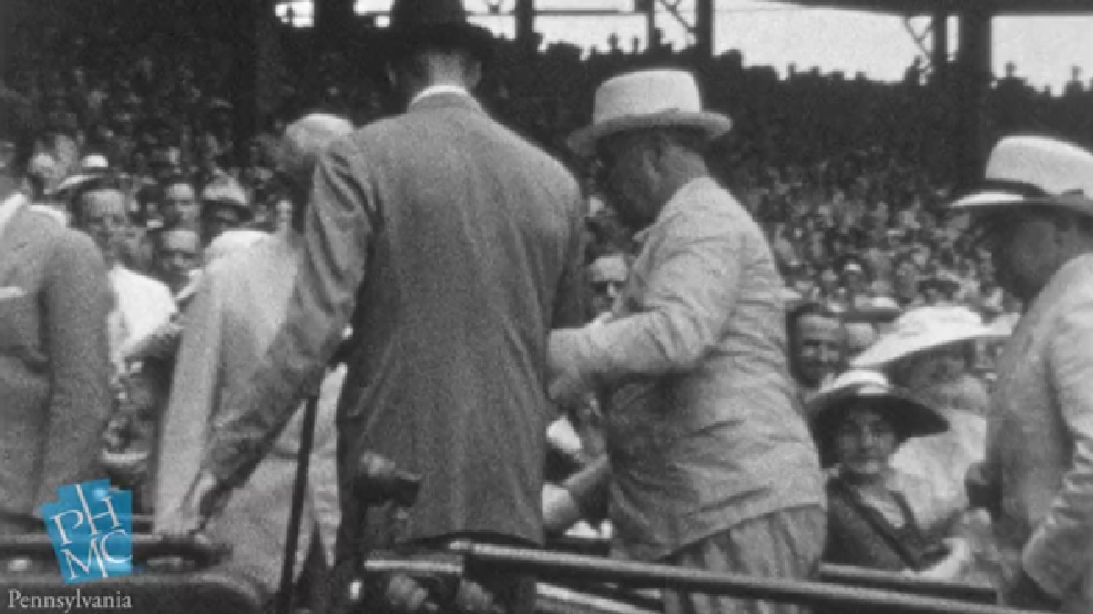 In this image taken from film shot by former Major League Baseball player Jimmie DeShong and acquired by the Pennsylvania Historical & Museum Commission, President Franklin D. Roosevelt, center right, walks to his seat with the aid of an assistant at the Major League Baseball All-Star game on July 7, 1937 at Griffith Stadium in Washington. The rare footage helps dispel the myth that he tried to hide his disability and shows the courage it took to go about his daily life, experts said Friday, May 16, 2014. (AP Photo/Pennsylvania Historical & Museum Commission)