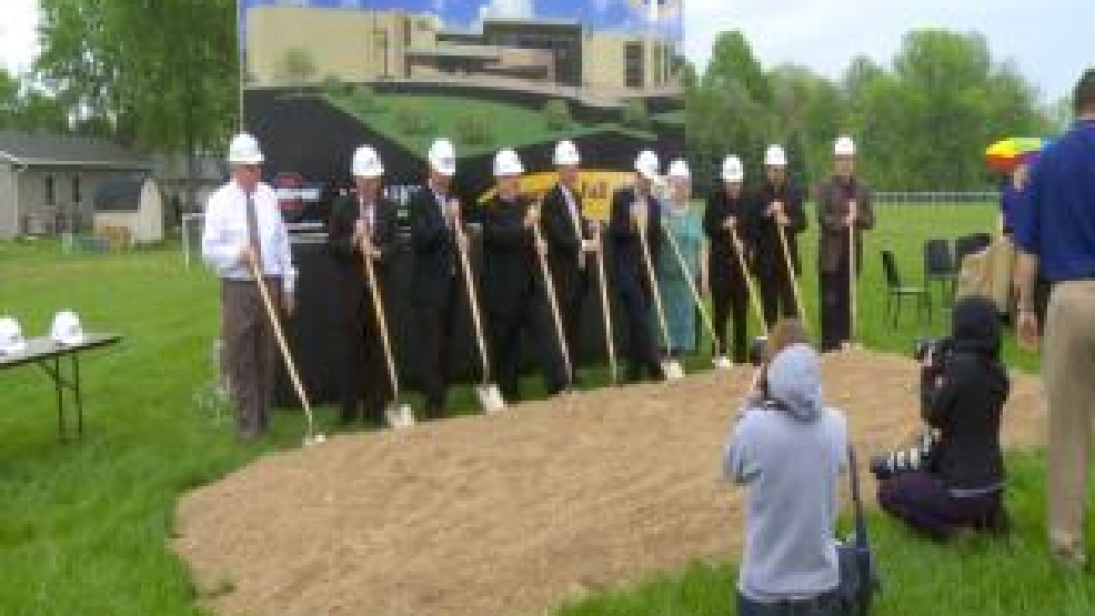 Catholic Diocese of Green Bay Bishop David Ricken helps break ground May 27, 2014, for the new St. Mary middle school in Neenah. (WLUK/Chad Doran)