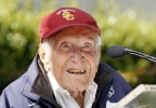 In a Friday May 9, 2014 file photo, Louis Zamperini gestures during a news conference, in Pasadena, Calif. (AP Photo/Nick Ut, File)