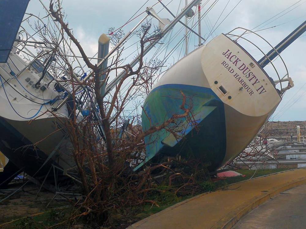 This Thursday, Sept. 7, 2017 photo shows boats washed ashore in the aftermath of Hurricane Irma in Tortola, in the British Virgin Islands. Irma scraped Cuba's northern coast Friday on a course toward Florida, leaving in its wake a ravaged string of Caribbean resort islands strewn with splintered lumber, corrugated metal and broken concrete. (Jalon Manson Shortte via AP)
