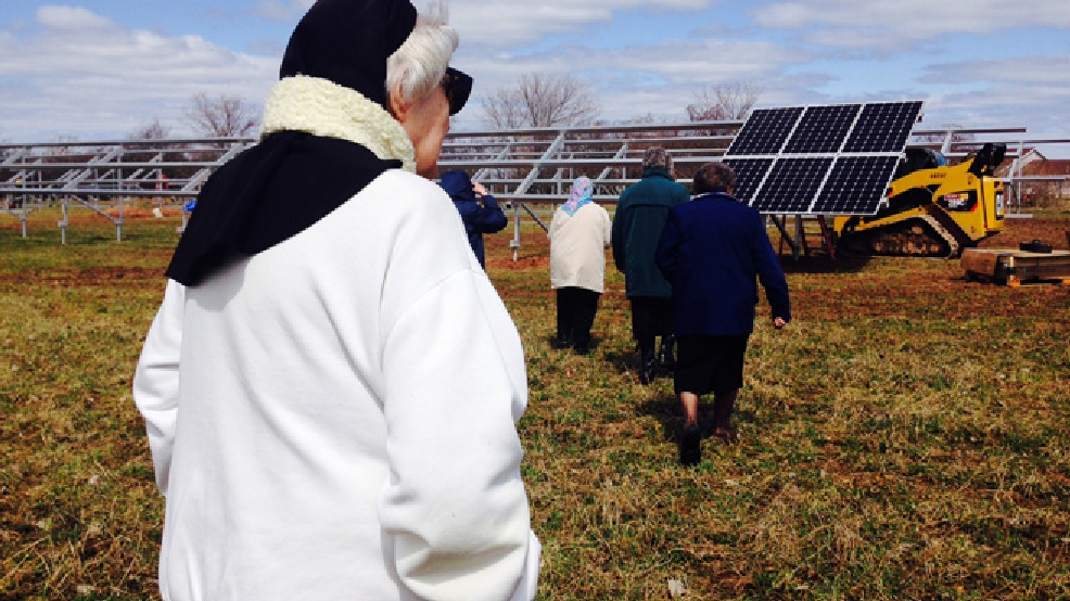 Nuns from the Sisters of St. Francis of the Holy Cross in Green Bay explore their new solar panels, April 22, 2014. (WLUK/Gabrielle Mays)
