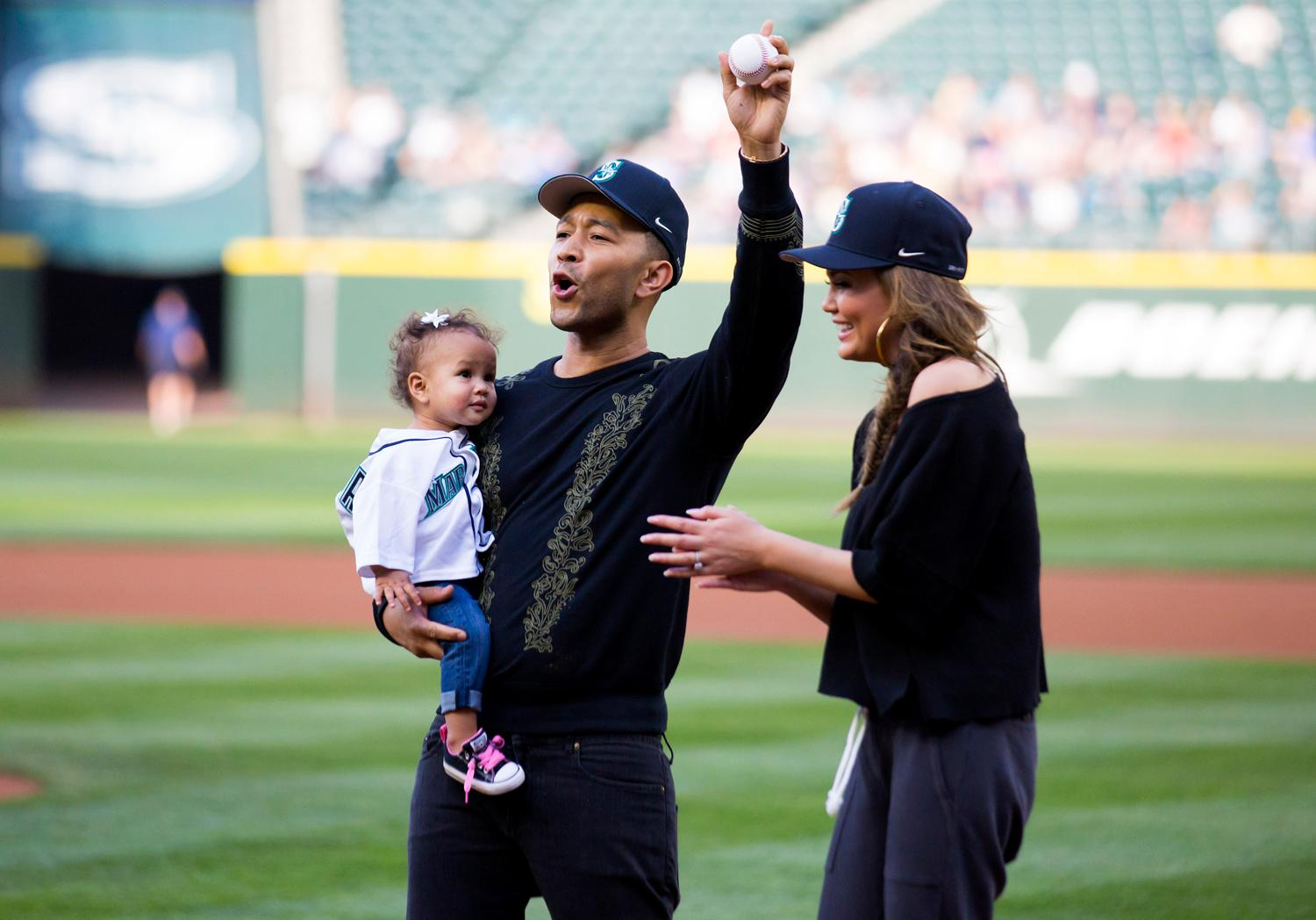 Team Legend for the win! Singer John Legend, his wife and model Chrissy Teigen and their one-year-old daughter Luna collectively threw out the first pitch at the Mariners game tonight (June 6, 2017). The singer was in town over the weekend for back to back concerts at Chateau Ste. Michelle's concert series, both of which were sold out. Teigen is a local gal, who grew up in Snohomish. (Sy Bean / Seattle Refined)