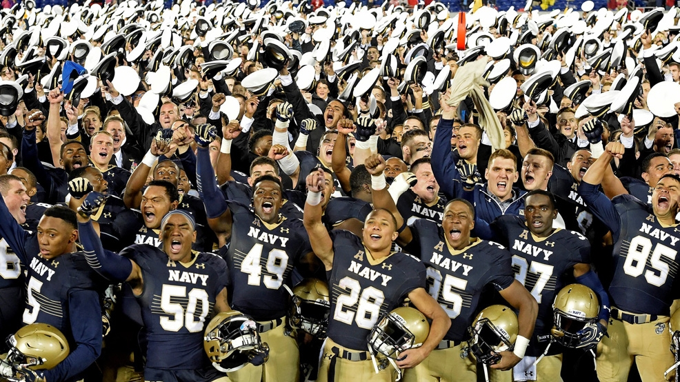 Navy celebrates its 46-40 victory over Houston, the Midshipmen's first victory against a team ranked in the Top 10 since beating South Carolina in 1984. (Courtesy Phil Hoffmann/Naval Academy Athletic Association)
