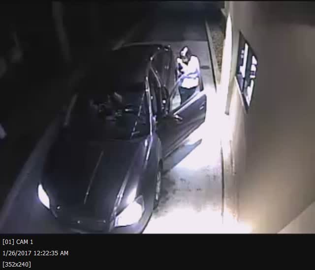 A still image from surveillance video shows a man and a woman leaving two cats at a drive-thru window in Coventry. (Coventry Police Department)
