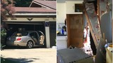 Driver crashes into garage, home on M-22