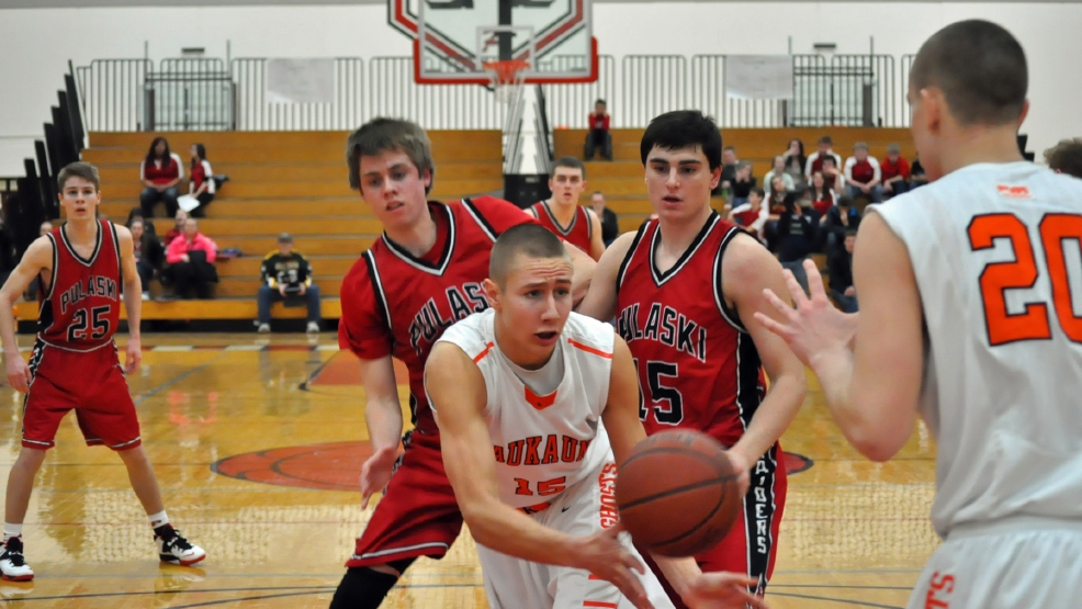 Kaukauna's Trent Nytes looks to pass the ball against Pulaski during their game Friday. (Doug Ritchay/WLUK)