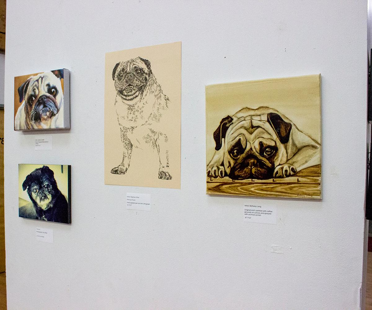 Pacific Pug rescue transformed a location in North Portland to a temporary café and art show Saturday, Jan. 3, 2018 and invited the public to sip coffee and eat doughnuts all while enjoying the company of dozens of pugs. The sold-out event drew a wide variety of pugs and their owners to raise money for the nonprofit. Photo by Amanda Butt