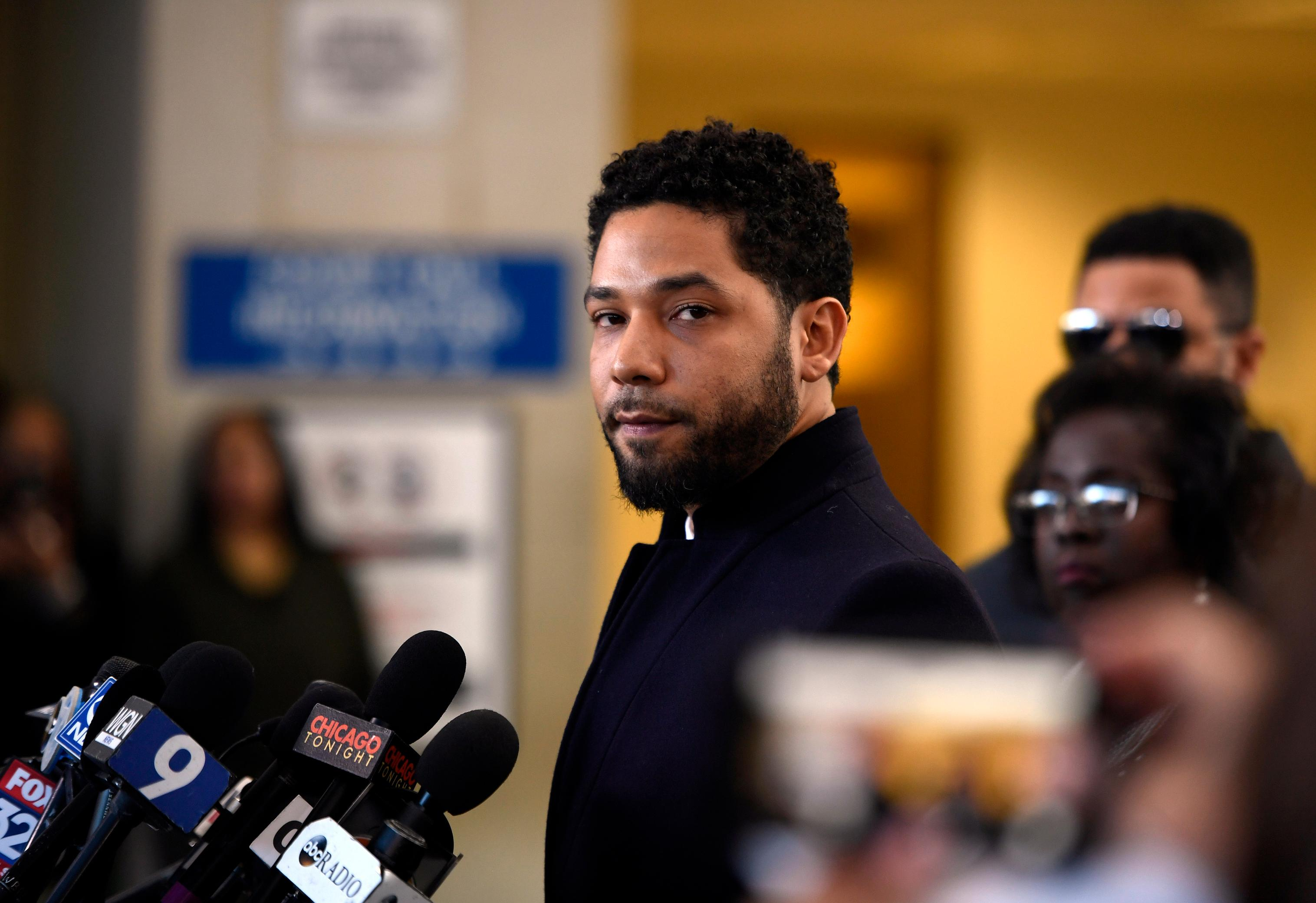 "FILE - In this March 26, 2019 file photo, Actor Jussie Smollett talks to the media before leaving Cook County Court after his charges were dropped, in Chicago. Chicago's top prosecutor has released 2,000 documents in the Jussie Smollett's case and explained she recused herself from an investigation into his claim he'd been the target of a racist, anti-gay attack solely because of false rumors she was related to the ""Empire"" actor. The Friday, May 31, 2019 statement from Cook County State's Attorney Kim Foxx came two months after her office's suddenly dropped all charges against Smollett that accused him of staging the attack on himself. (AP Photo/Paul Beaty, File)"