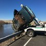 Man booked into jail after car is submerged in the Yakima River