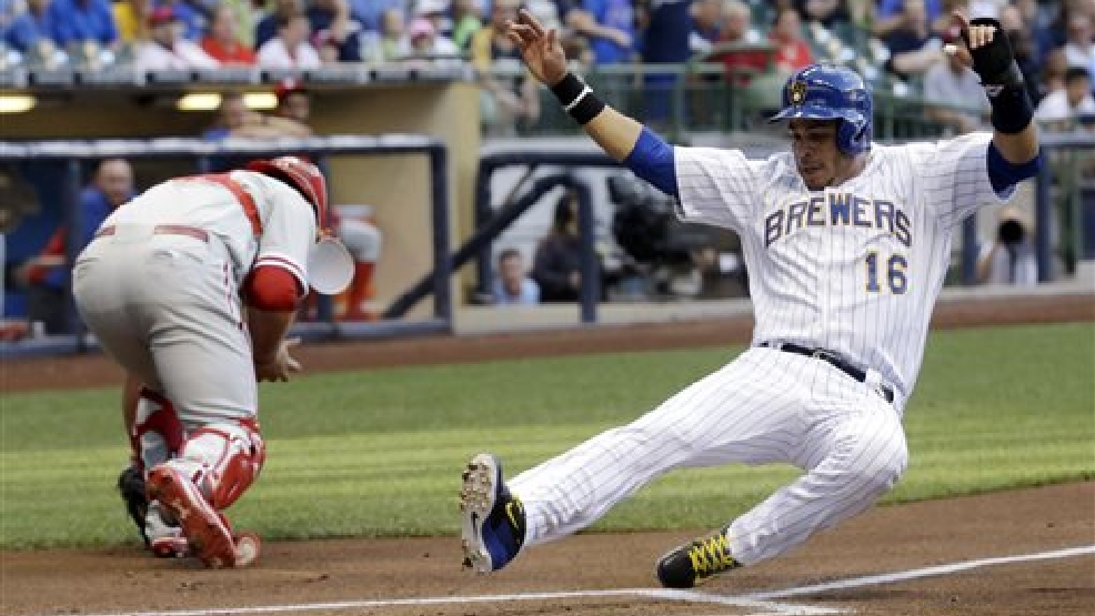 Milwaukee Brewers' Aramis Ramirez slides safely past Philadelphia Phillies catcher Cameron Rupp during the second inning of a baseball game Wednesday, July 9, 2014, in Milwaukee. Ramirez scored from second on a hit by Lyle Overbay. (AP Photo/Morry Gash)