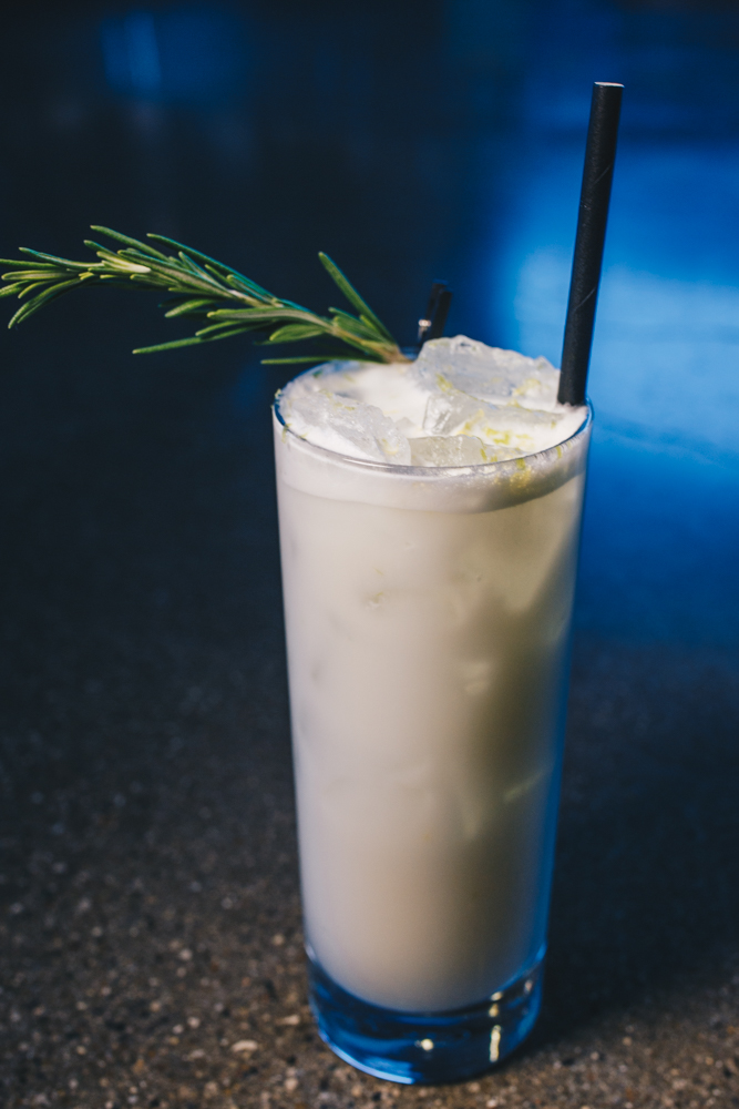 Nights in White Satin: New Riff BBA Kentucky Wild Gin, heavy cream, orgeat, lemon, lime, egg white, club soda, and garnished with fresh rosemary and lemon & lime zest{ }/ Image: Catherine Viox // Published: 3.25.19