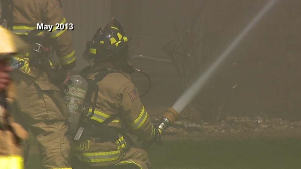 Firefighters battled flames at the Hilltop Place Apartments in Allouez on May 23, 2013.