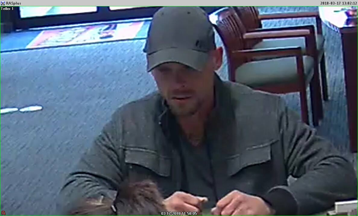 <p>Barboursville police are searching for a man who they said robbed the First Sentry Bank on Mud River Road Saturday morning. (Barboursville Police Department)</p>