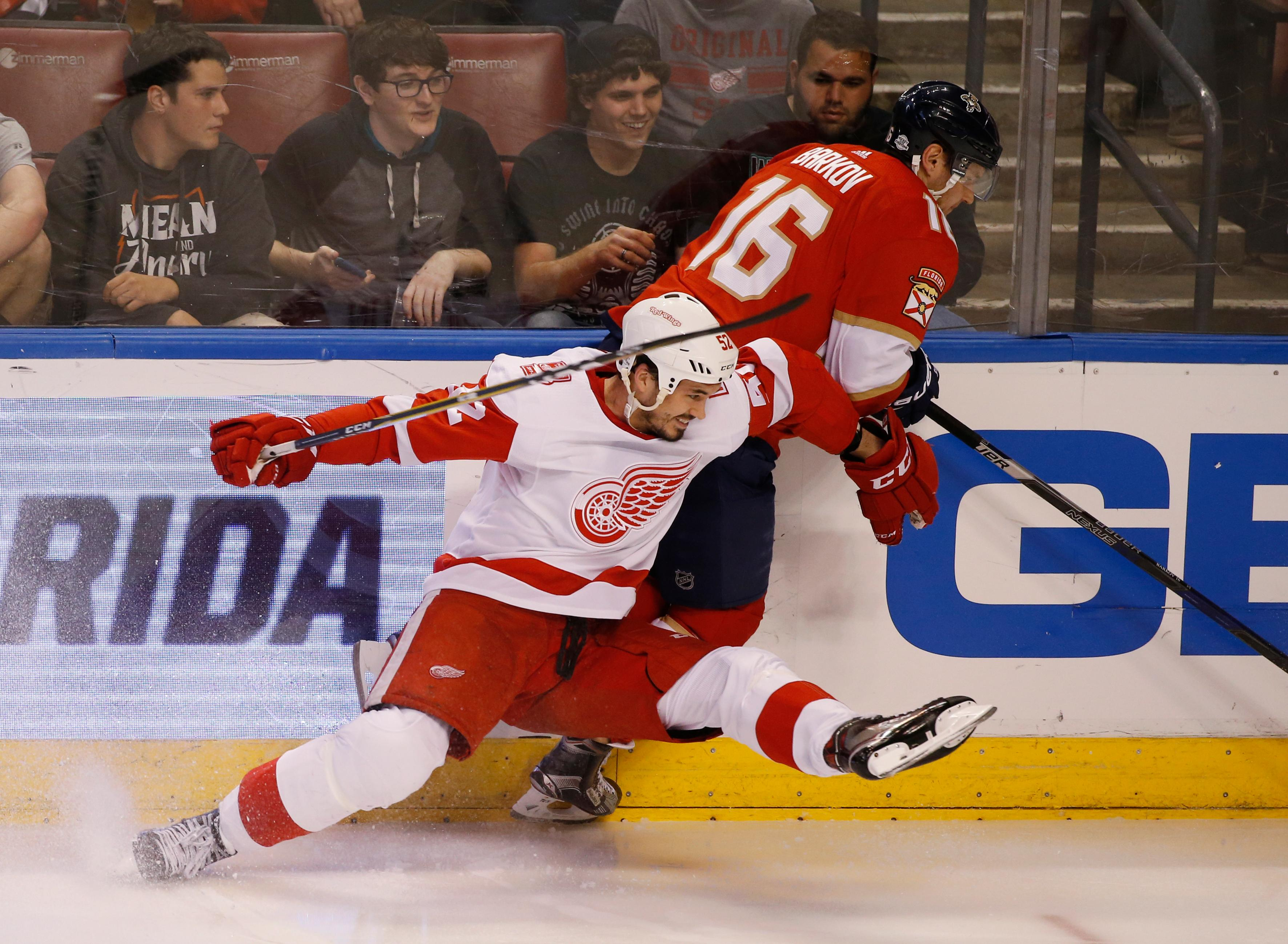 Detroit Red Wings defenseman Jonathan Ericsson, foreground, and Florida Panthers center Aleksander Barkov (16) battle for the puck during the second period of an NHL hockey game, Saturday, Feb. 3, 2018 in Sunrise, Fla. (AP Photo/Wilfredo Lee)