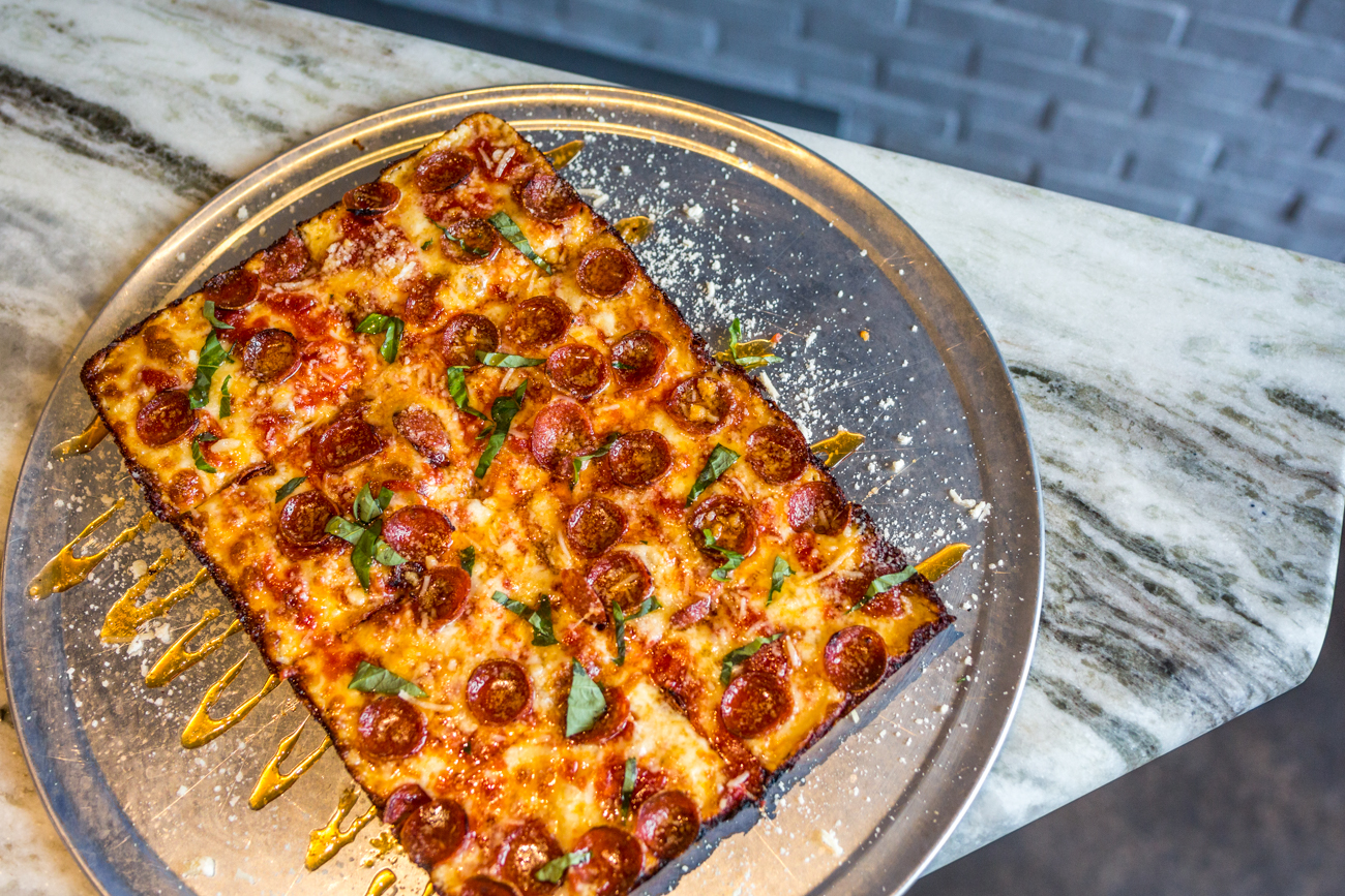 Detroit-style Pepperoni and Hot Honey Pizza: tomato sauce, mozzarella, pepperoni, basil, Mike's Hot Honey, and parmigiano reggiano / Image: Catherine Viox{ }// Published: 7.12.19