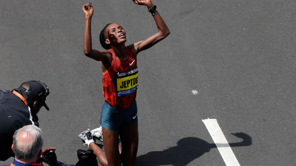 Rita Jeptoo, of Kenya, celebrates her win in the women's division of the 118th Boston Marathon Monday, April 21, 2014 in Boston. (AP Photo/Charles Krupa)