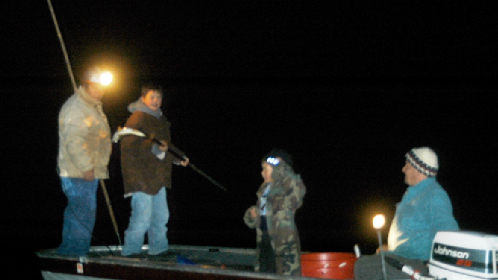 A Native American from the Lac du Flambeau band of the Ojibwe Tribe exercises his treaty right to spear walleye on a northern Wisconsin lake. (Wisconsin DNR)