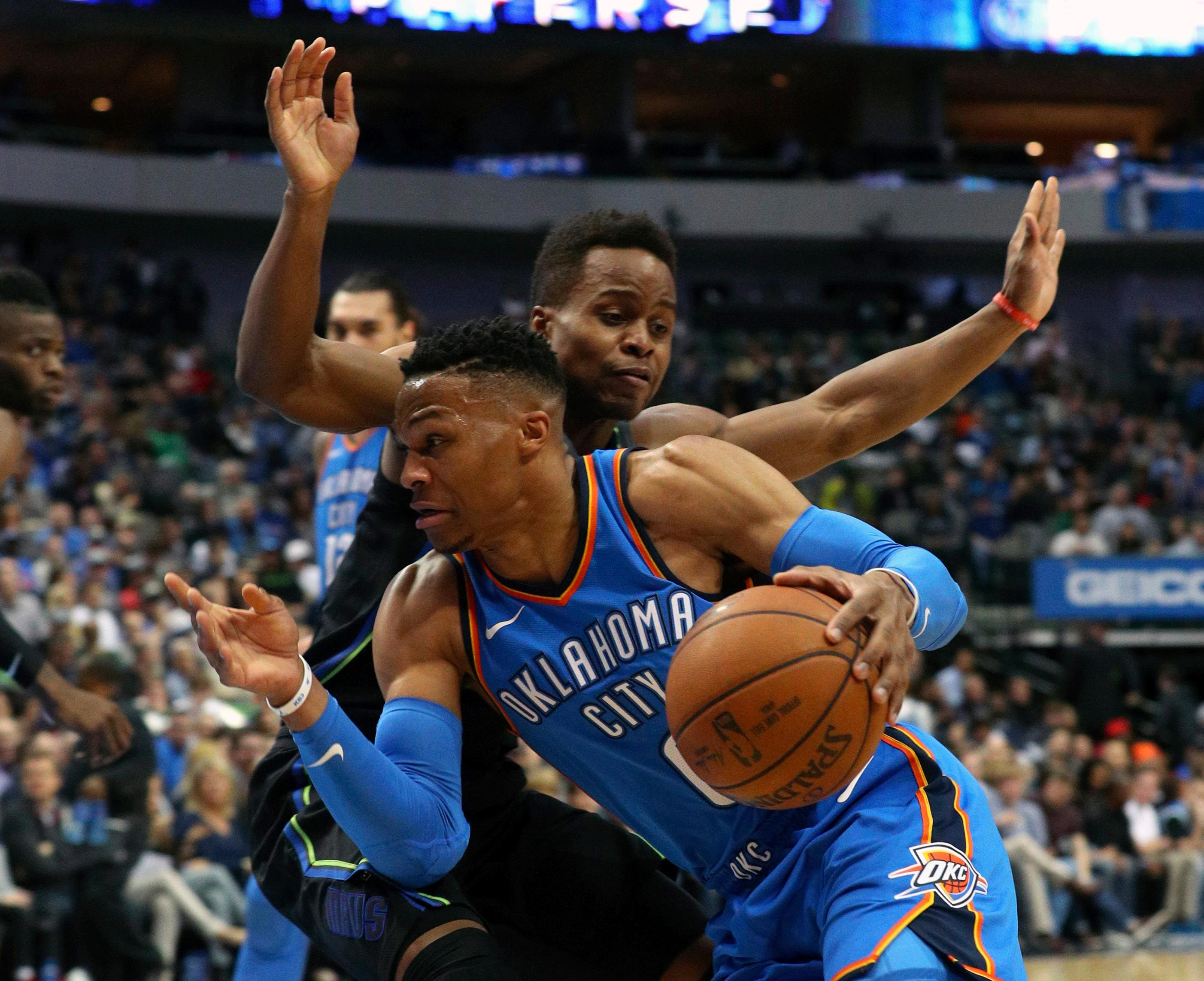 Oklahoma City Thunder guard Russell Westbrook (0) drives toward the basket as Dallas Mavericks guard Yogi Ferrell (11) defends during the first half of an NBA basketball game Wednesday, Feb. 28, 2018 in Dallas. (AP Photo/Richard W. Rodriguez)