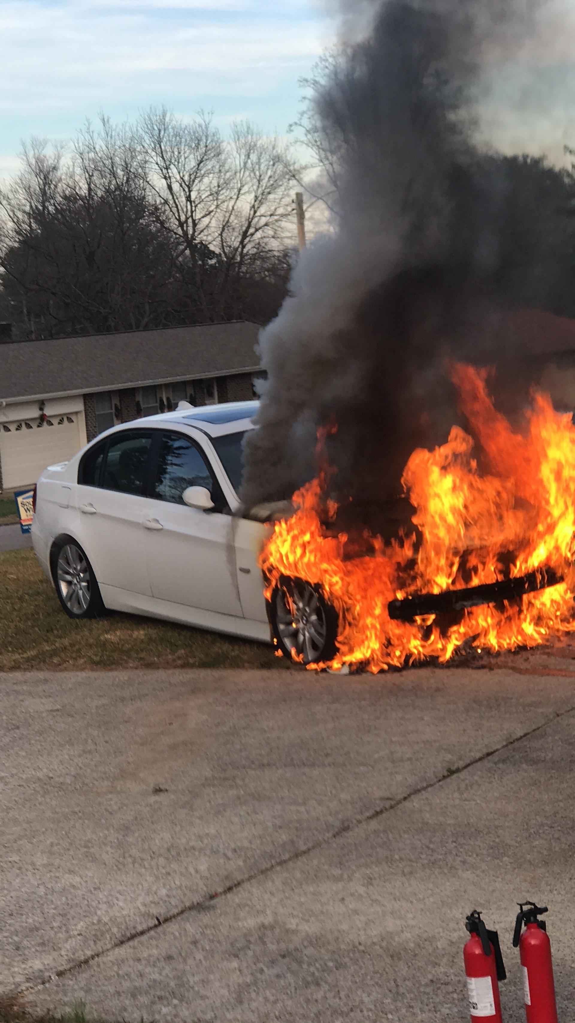 Kevin Muhammad walked out to his garage Sunday afternoon and saw his car on fire. His first instinct? Push it out to the yard. (Image: Kevin Muhammad)