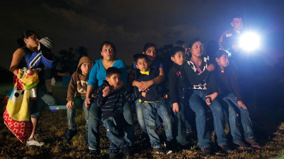 In this June 25, 2014 file photo, a group of immigrants from Honduras and El Salvador who crossed the U.S.-Mexico border illegally are stopped in Granjeno, Texas. (AP Photo/Eric Gay)