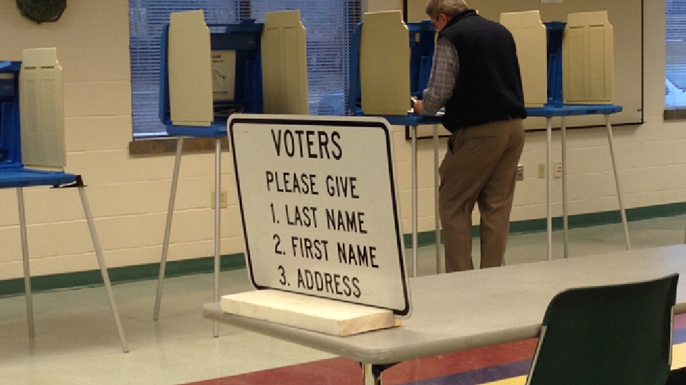 A voter casts his ballot at the De Pere Community Center, April 1, 2014. (WLUK/Pauleen Le)