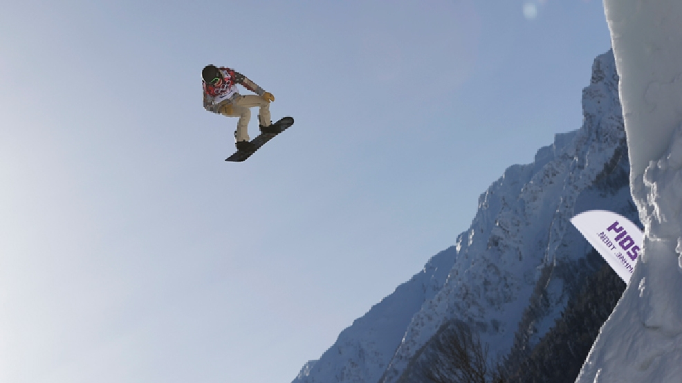 FILE - In this Tuesday, Feb. 4, 2014 file photo, Shaun White of the United States takes a jump during a Snowboard Slopestyle training session at the Rosa Khutor Extreme Park in Krasnaya Polyana, Russia, prior to the 2014 Winter Olympics. (AP Photo/Andy Wong, File)
