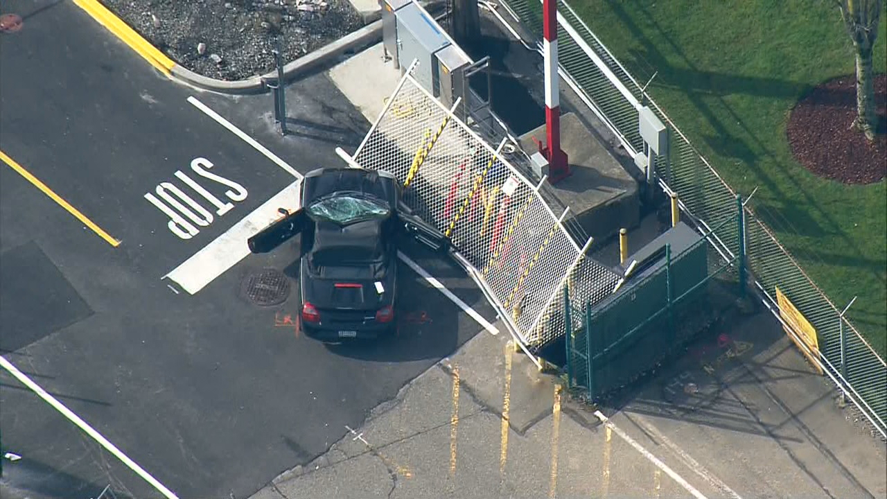 Emergency crews respond after a pedestrian was hit and critically injured after a car being pursued by police crashed through a gate at Boeing's Renton plant on Monday, April 9, 2018. (Photo: KOMO News)