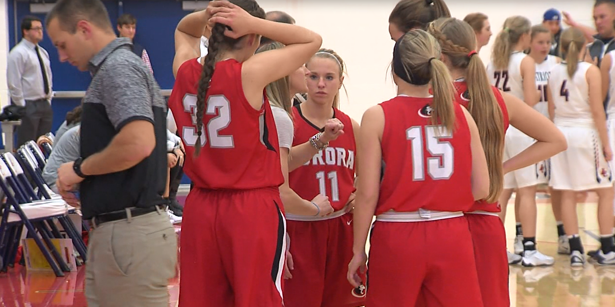 Aurora's Adyson Narber (11) and the Huskies huddle during a game against Adams Central on Dec. 1, 2016 (NTV News)