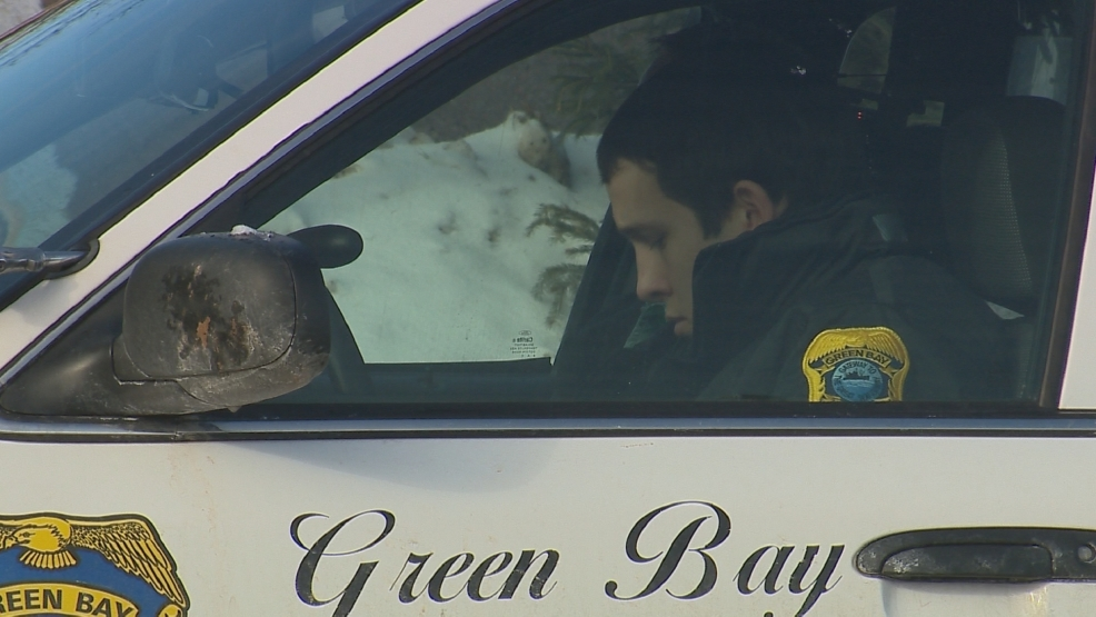 Green Bay Police Officer Kyle Schroeder sits in a squad car during the department's Mini Academy.