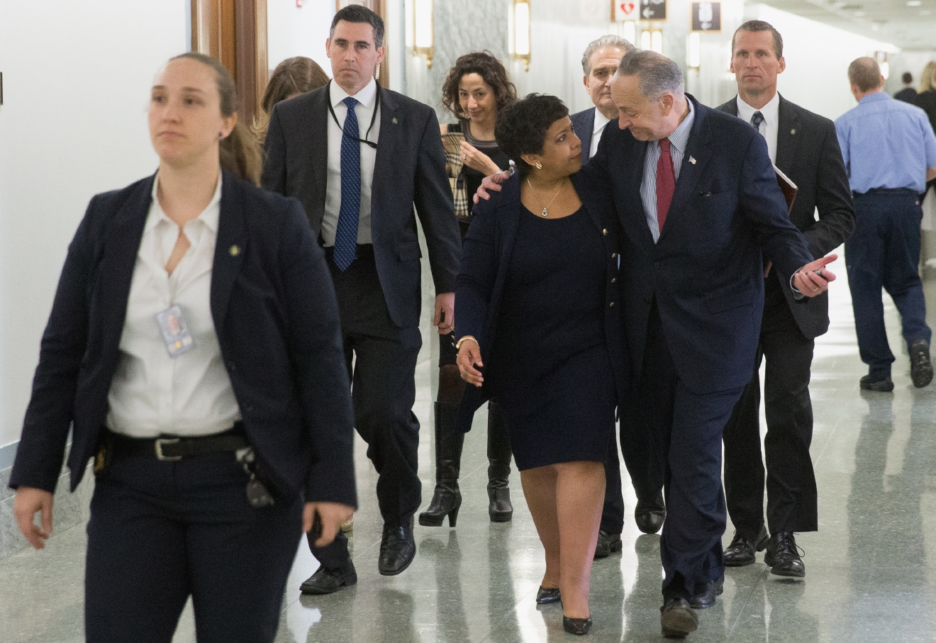 Attorney General Loretta Lynch walks with Sen. Charles Schumer, D-N.Y. as she arrives on Capitol Hill in Washington, Wednesday, March 9, 2016, to testify before the Senate Judiciary Committee hearing on oversight of the Justice Department. (AP Photo/Andrew Harnik)