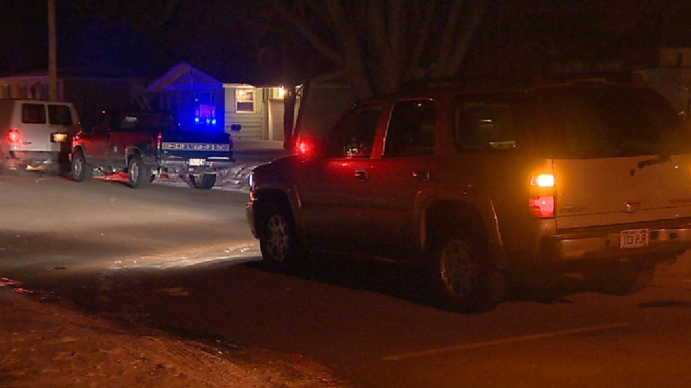 Authorities investigate a shooting that left two people dead on Bowen St. in Brandon, March 5, 2014. (WLUK)