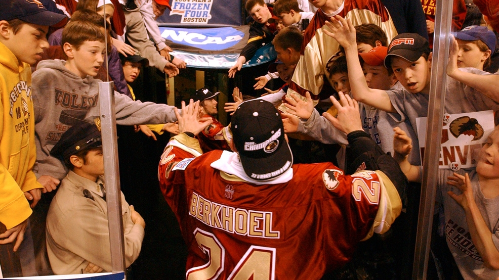 Denver goalie Adam Berhkoel high-fives after shutting out Maine, 1-0, to win the NCAA men's hockey championship game on April 10, 2004, at FleetCenter in Boston. He made the two biggest of his 24 saves when Maine had a 6-on-3 advantage. (Photo By Andy Cross/The Denver Post via Getty Images)