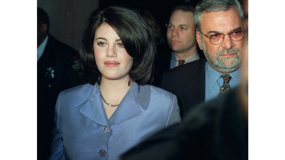 FILE - Monica Lewinsky and her attorney William Ginsburg, right, leave a Washington restaurant Saturday night, Feb. 21, 1998. (AP Photo/Charles Rex Arbogast, File)