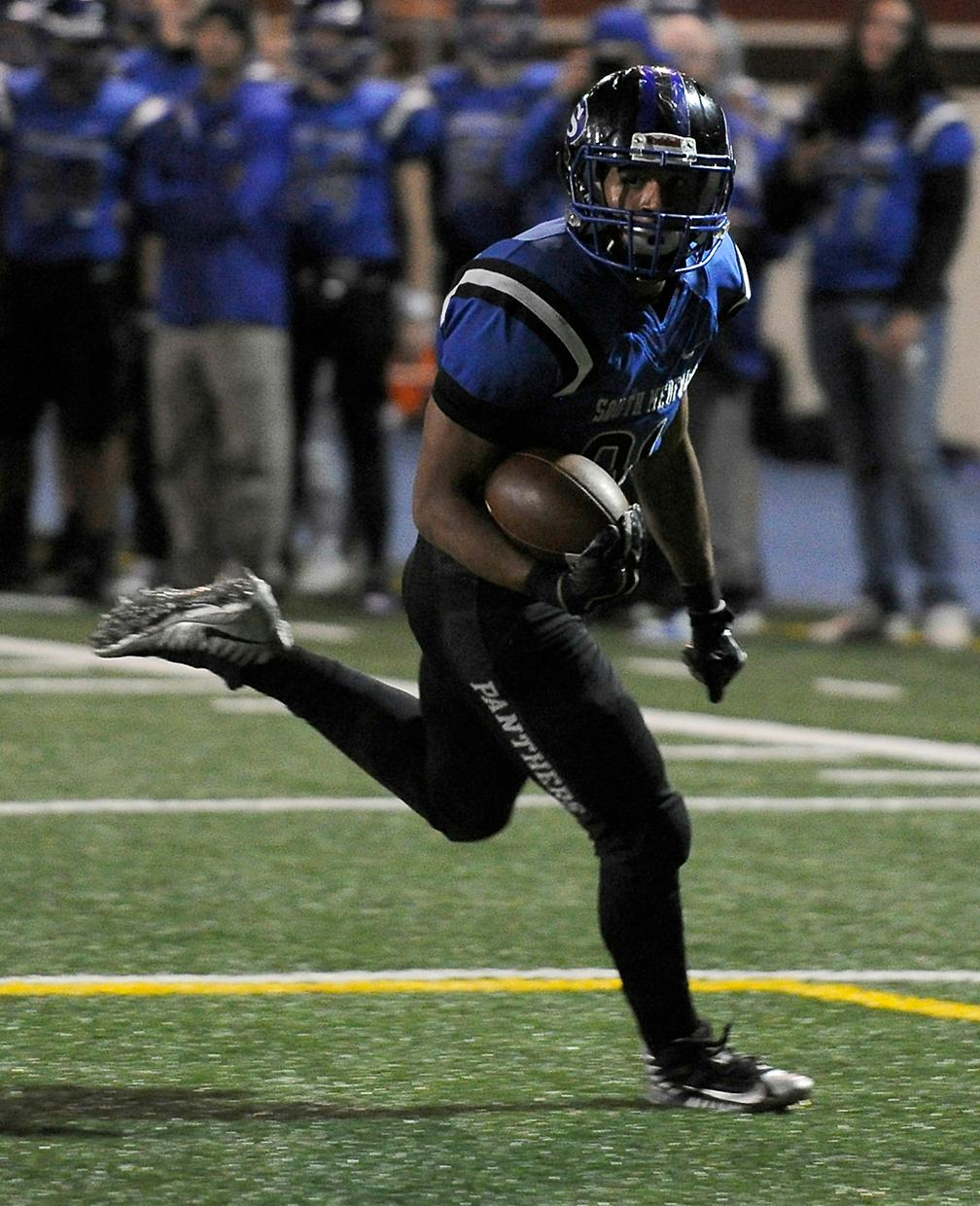 Andy Atkinson / Mail Tribune{ } South's Terrence Butler goes untouched to the endzone for a touchdown in the 3rd quarter.