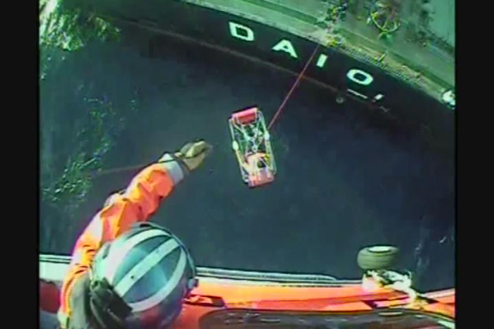 The Coast Guard Sector North Bend performed a medical evacuation from a cargo vessel. The crewmember suffered a severe laceration to his head. Image cut from U.S. Coast Guard footage