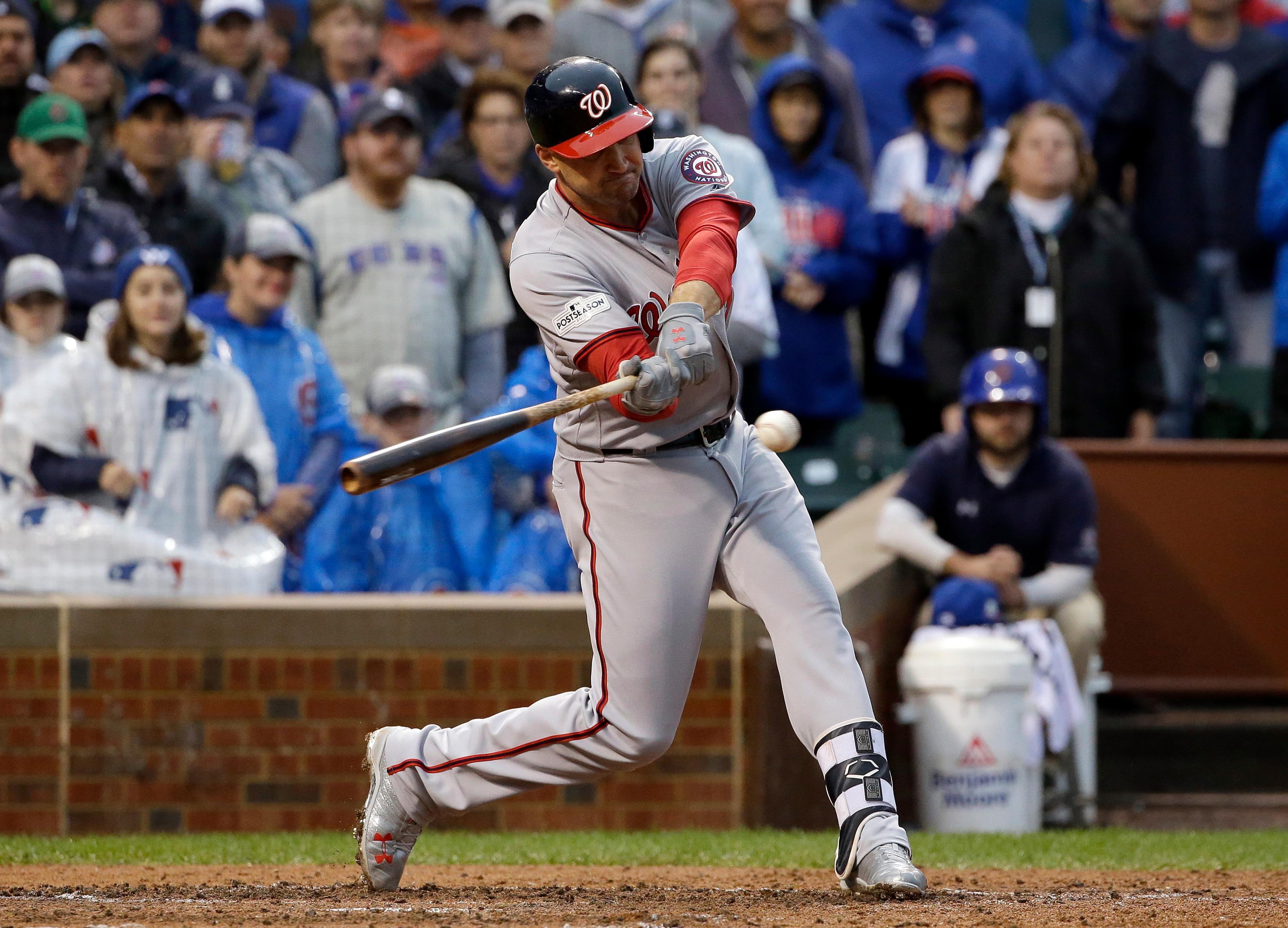 Washington Nationals' Ryan Zimmerman hits as Trea Turner scores a run on a fielding error by Chicago Cubs' Addison Russell Chicago during the third inning of Game 4 of baseball's National League Division Series, Wednesday, Oct. 11, 2017, in Chicago. (AP Photo/Nam Y. Huh)