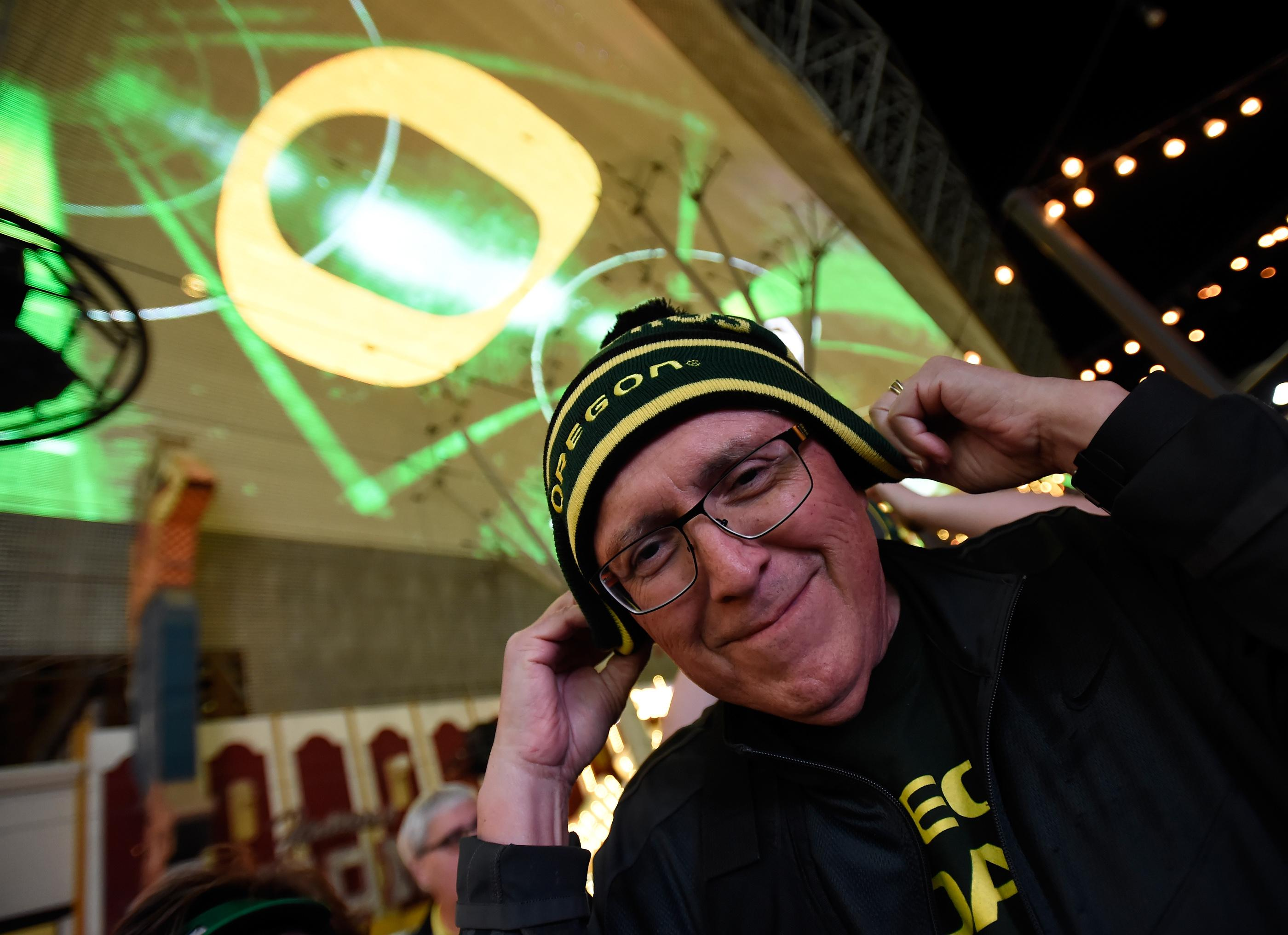An Oregon fan bundles up during a pep rally at the Fremont Street Experience Friday, Dec. 15, 2017, in Las Vegas. The Boise State Bronco will take on the Oregon Ducks in the 26th edition of the Las Vegas Bowl at Sam Boyd Stadium on Saturday. CREDIT: David Becker/Las Vegas News Bureau