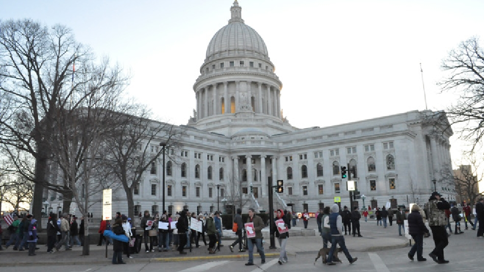 Protesters march outside the state Capitol in Madison, Feb. 19, 2011. (WLUK)