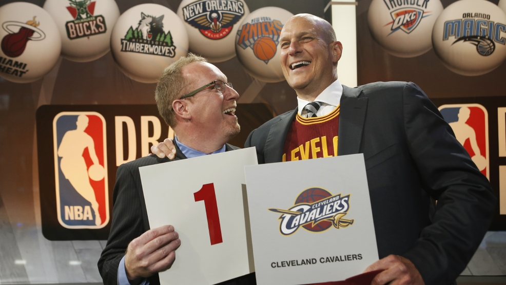 Cleveland Cavaliers general manager David Griffin, left, and minority owner Jeff Cohen celebrate after the Cavaliers won the top pick in the the NBA basketball draft lottery in New York, Tuesday, May 20, 2014. It's the third time in four years the Cavs will be atop the draft after moving up from the ninth spot. (AP Photo/Kathy Willens)