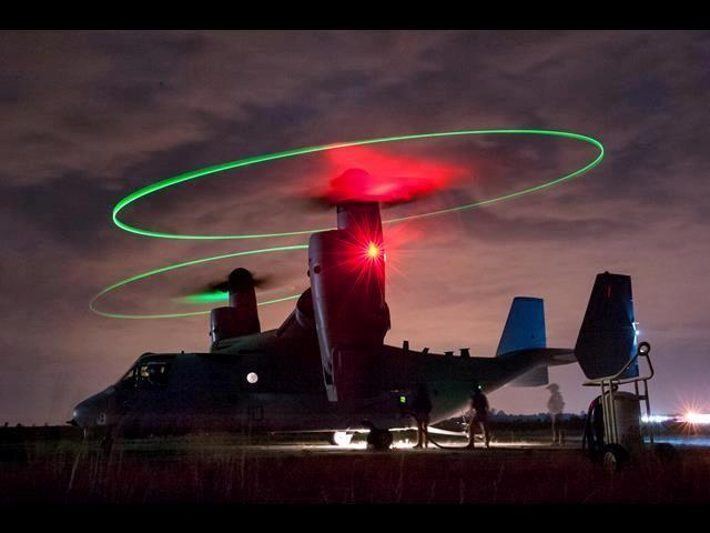 Marines fuel an MV-22 Osprey at a forward air refueling point on McEntire Joint National Guard Base, S.C., May 14, 2014.