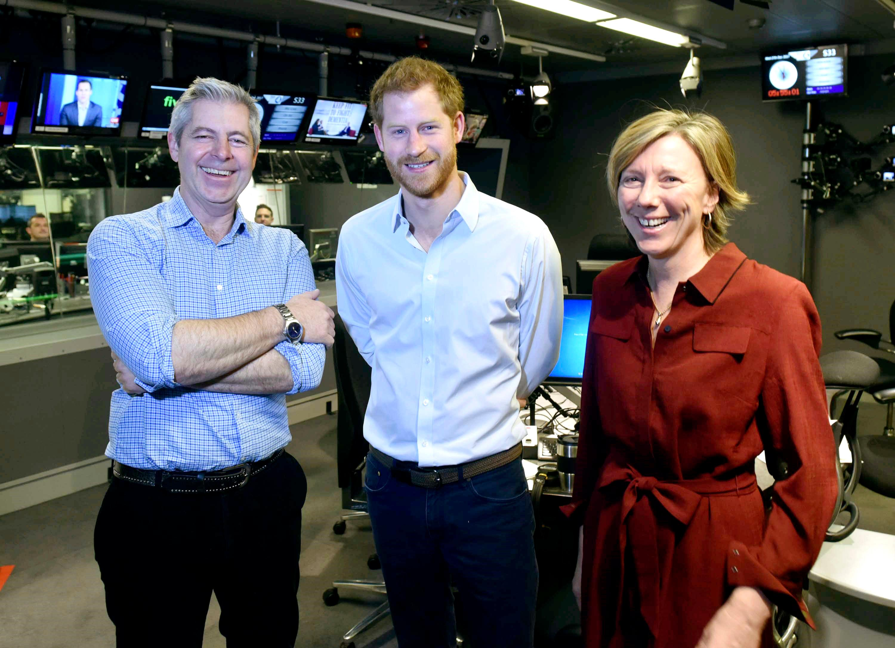 In this BBC handout photograph released on Wednesday, Dec. 27, 2017, Britain's Prince Harry, centre, poses for a photo with presenters Justin Webb and Sarah Montague in the studio for the Radio 4 Today programme which he has guest edited, in London. (Jeff Overs /BBC/PA via AP)