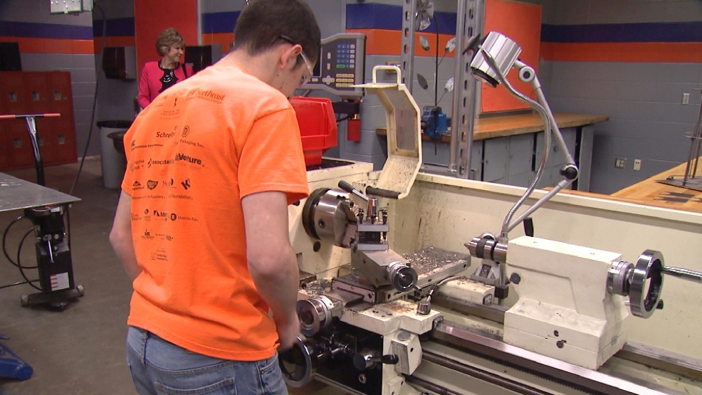 Students at Bay Link Manufacturing at Green Bay West High School use machines to shape class projects on Monday, April 20, 2015.