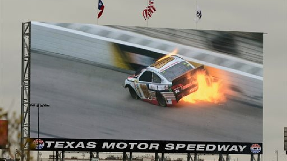 A video screen shows a replay of Dale Earnhardt Jr.'s (88) car during a wreck at the NASCAR Sprint Cup series auto race at Texas Motor Speedway, Monday, April 7, 2014, in Fort Worth, Texas. (AP Photo/Larry Papke)