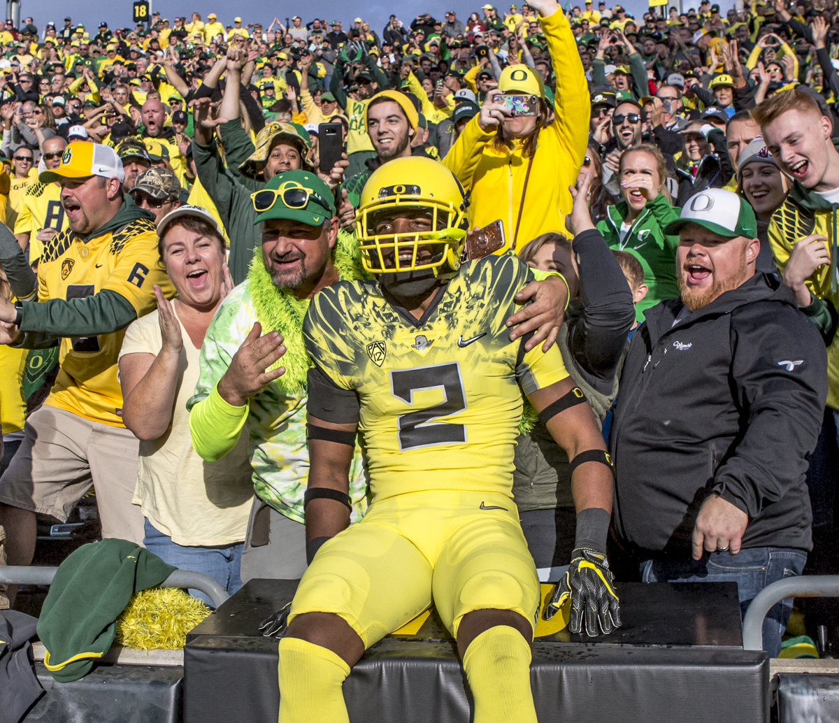 Oregon safety Tyree Robinson (#2) leaps into the crowd before kickoff. The Oregon Ducks trail the Washington State Cougars 10 to 13 at the end of the first half. Photo by Ben Lonergan, Oregon News Lab