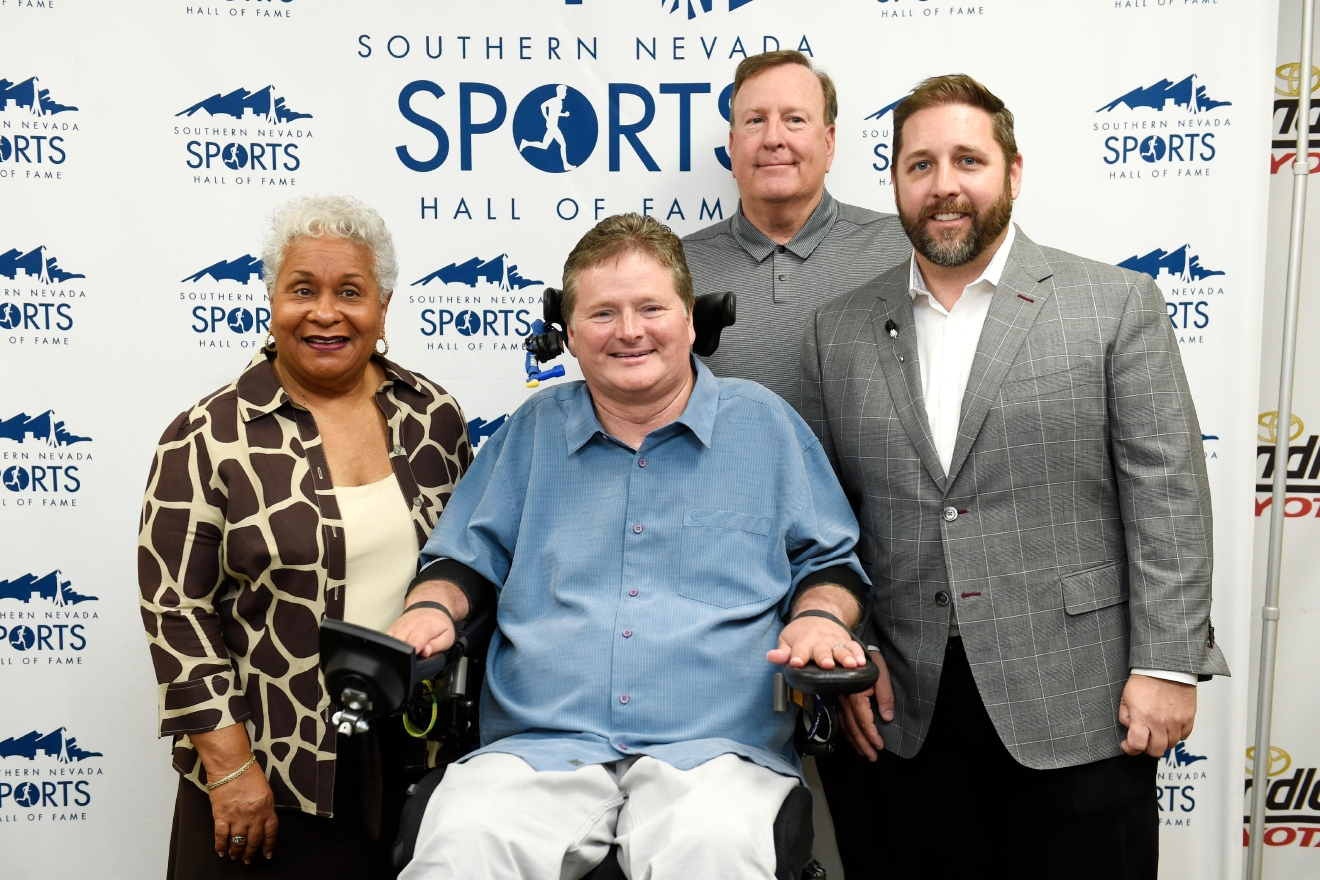From left, Connie Curtis, Sam Schmidt, Eric Dutt and John Saccenti pose for a photo during a news conference to announce the 2017 inductees into the Southern Nevada Sports Hall of Fame Tuesday, March 14, 2017. Curtis was representing her late husband Overton Curtis and Dutt was representing Butch Harmon. [Sam Morris/Las Vegas News Bureau]